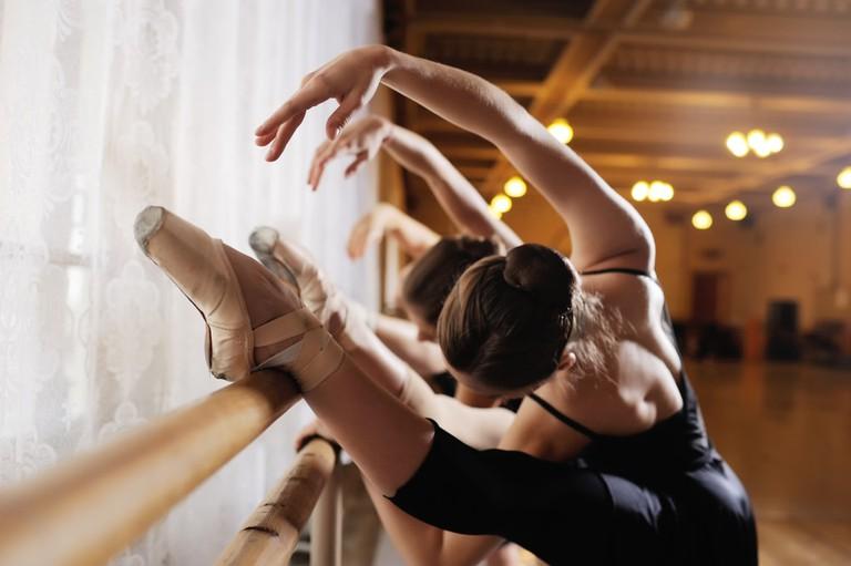 Ballerinas practicing barre exercises