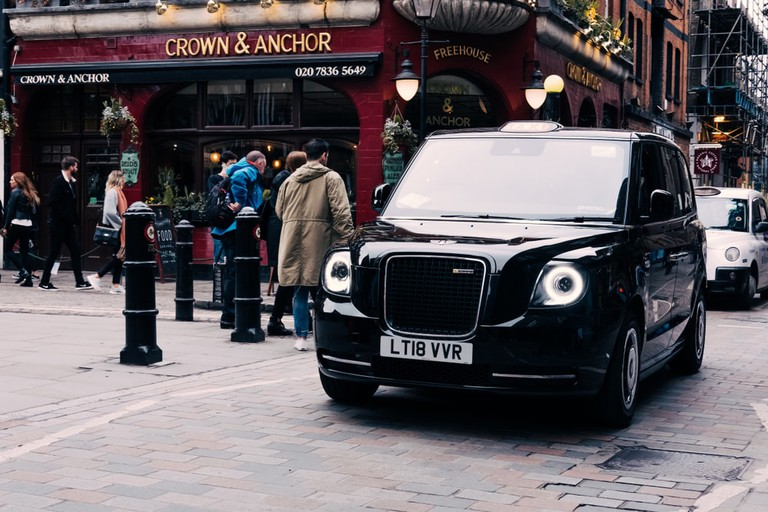 New electric LEVC TX London black cab on a street in Covent Garden, London