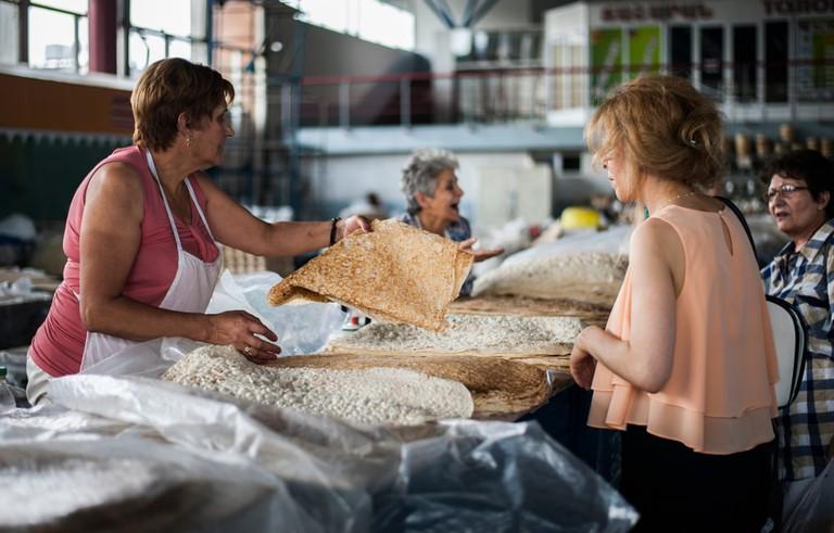 Armenian woman selling traditional Armenian lavash bread to tourists