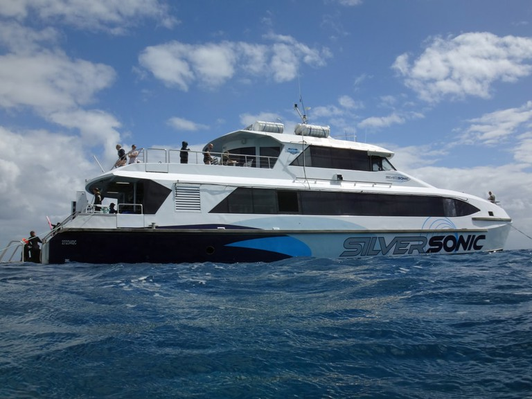 Silversonic boats taking tourists on Great Barrier Reef scuba and snorkelling trips at the Port Douglas Reef Marina in Far North Queensland, Australia