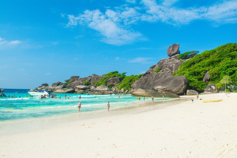 Tourists on the beautiful beach in Koh Similan island, Andaman Sea, Thailand