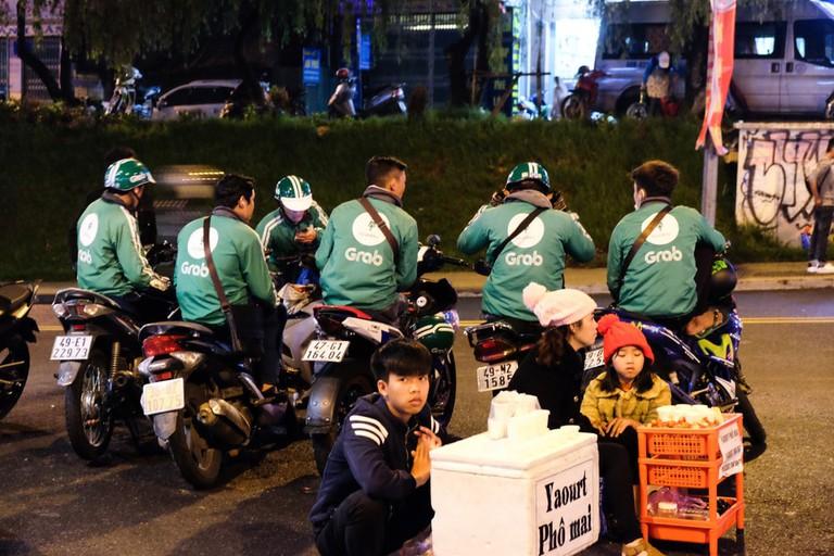 Grab bike taxi drivers waiting for customers, Dalat
