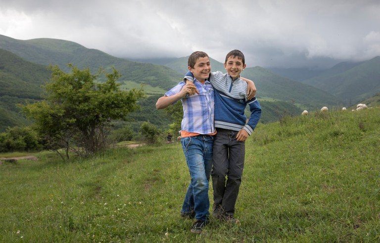 Armenian boys in a countryside