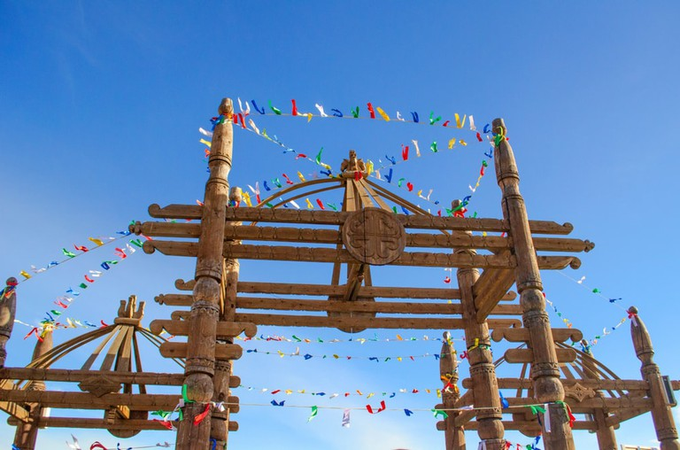 Yakut national gates decorated with ribbons