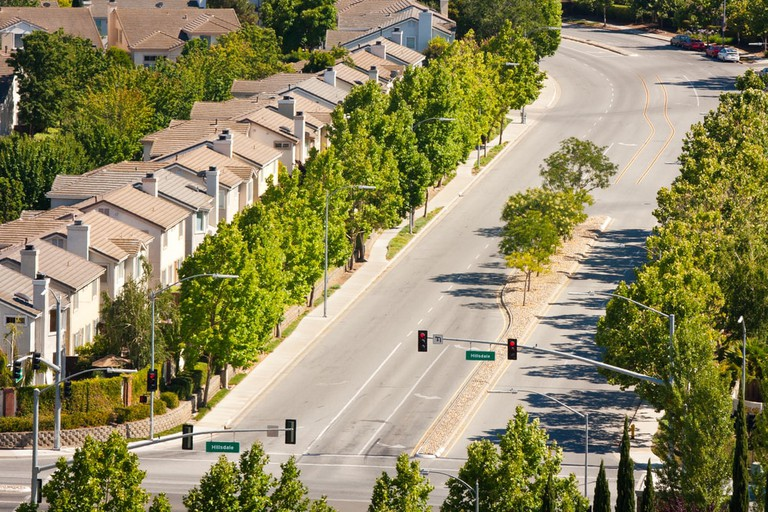 Tract homes along a wide street in San Jose
