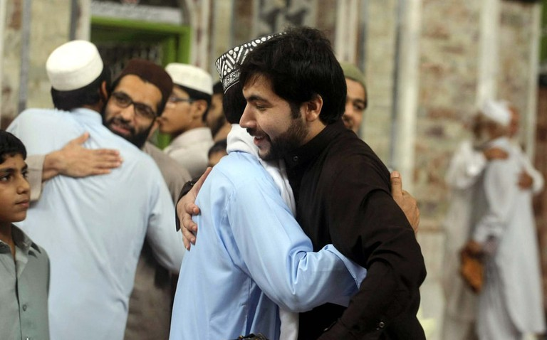 Muslims hugging each other after Eid-ul-Fitr prayer
