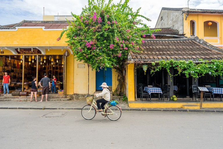 People is riding on bicycle on the street of the ancient town Hoi An