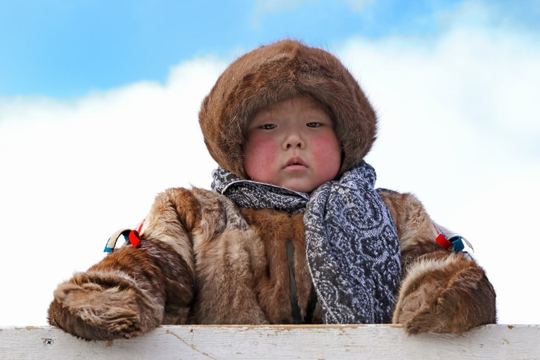 "Nenets boy in national clothes on a traditional holiday ""Day of the reindeer breeder"""