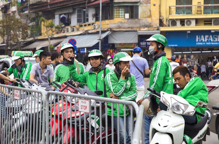Vietnamese Grab bike riders waiting for passenger on a street, Hanoi