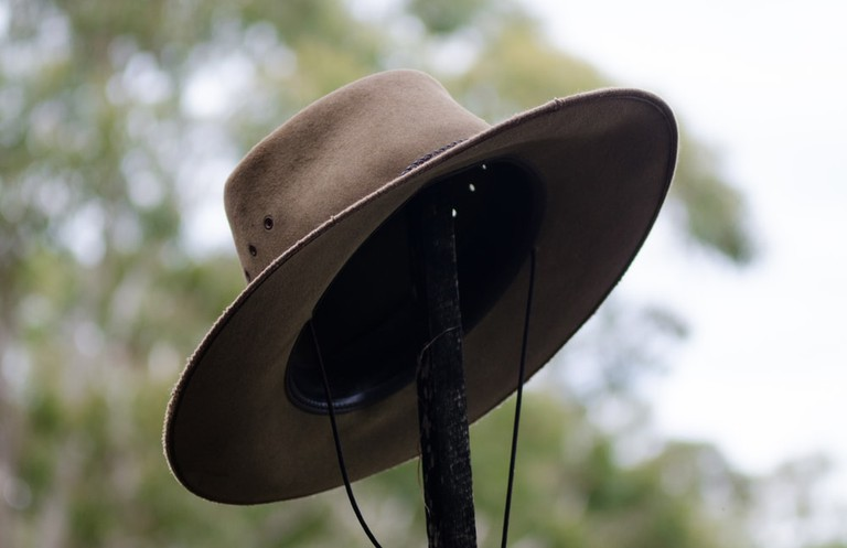 Australian wide brimmed bush hat hanging on post