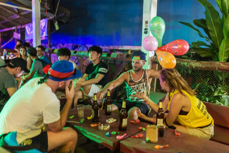 Backpackers at a Vang Vieng bar, Laos