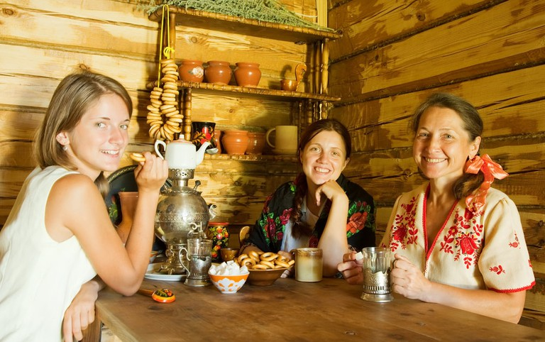 Three women having tea, Russian interior