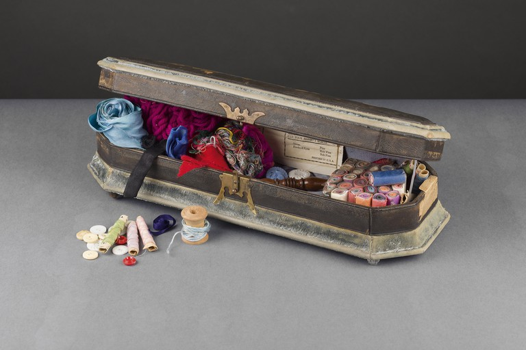 Frida's sewing box containing some pale-blue hair ribbons, which are of the type she plaited through her hair