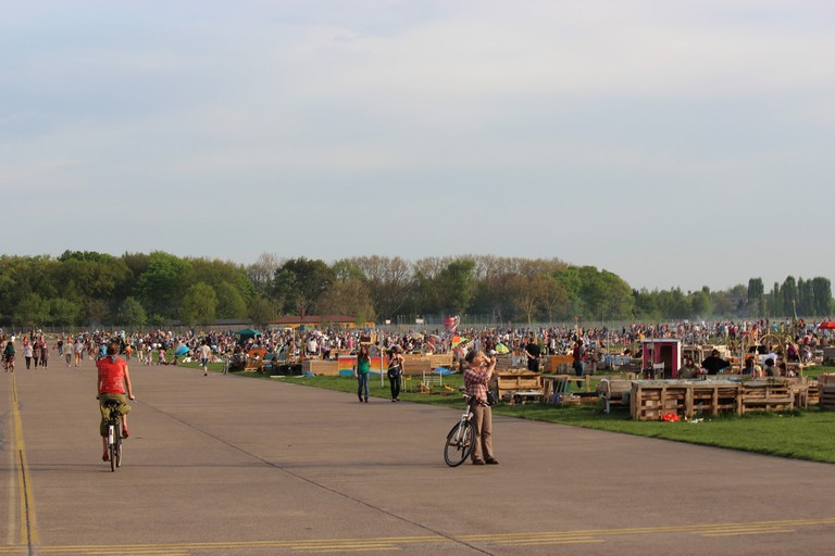Locals and tourist gather at Tempelhofer Feld