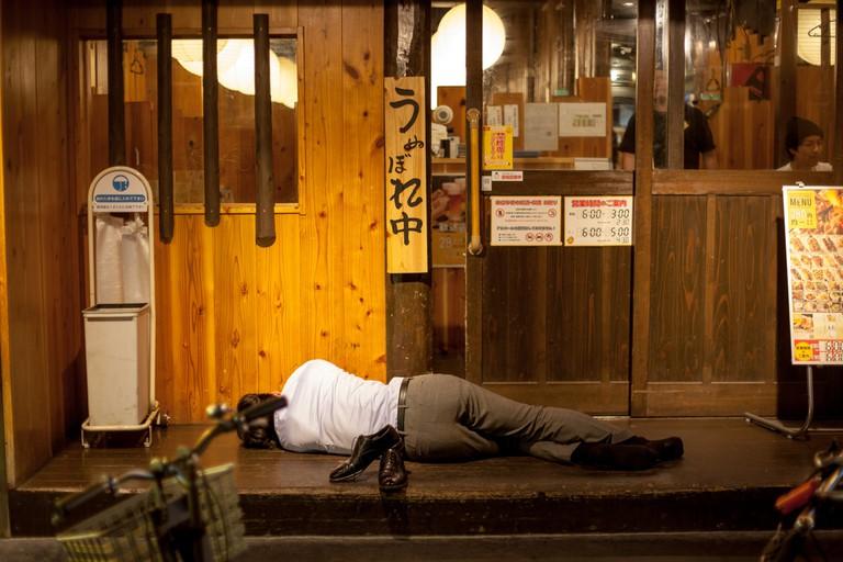 man_asleep_osaka