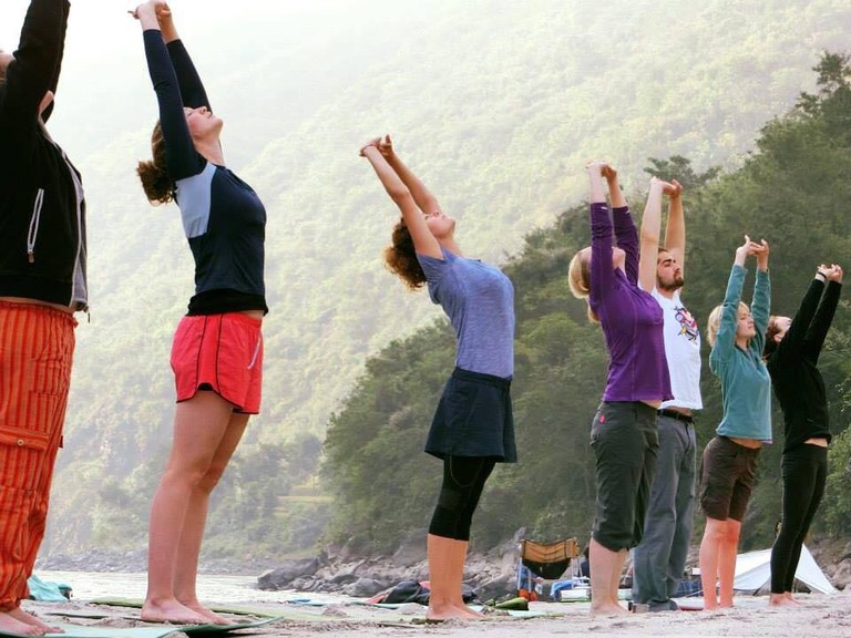 Morning yoga on the banks of the river