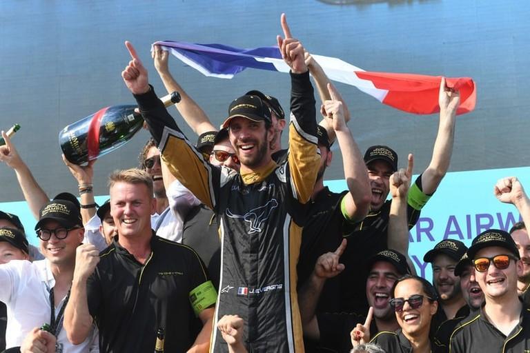 Jean-Éric Vergne (center) celebrates winning the 2017/18 Drivers' Championship