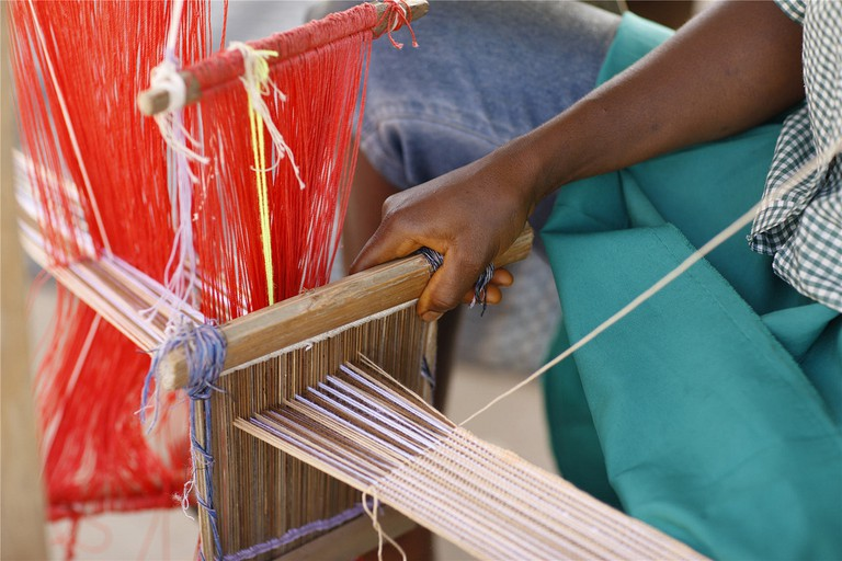 A Sierra Leonian weaving traditional cloth
