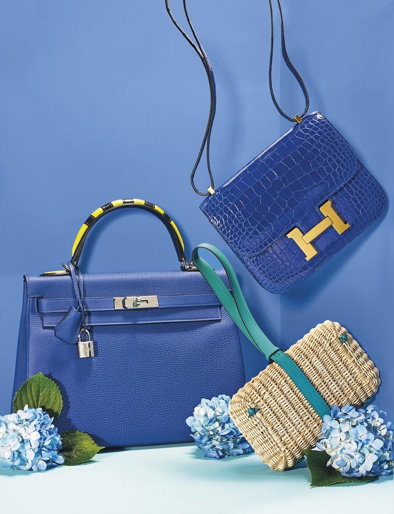 A selection of blue Hermès handbags