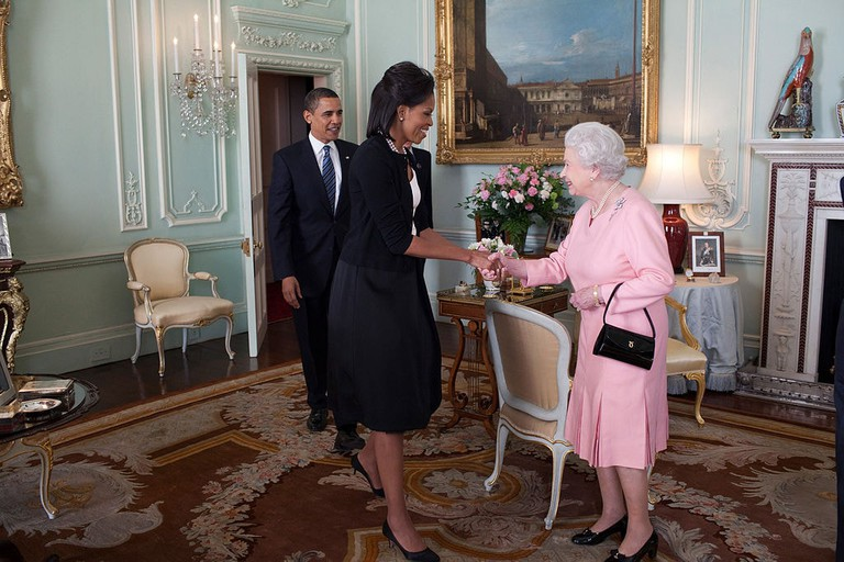 Barack Obama and First Lady Michelle Obama are welcomed by Queen Elizabeth II to Buckingham Palace, April 2009