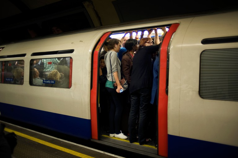 London underground tube comute crush overcrowded travel piccadilly line hot sweat straphanging bodies smell touch heat