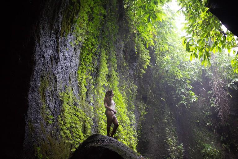 Silvia Njoki at Tukad Cepung Waterfall in Bali