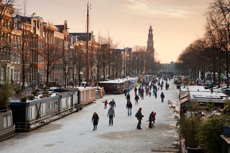 Winter ice skating on frozen canals, Amsterdam, Netherlands