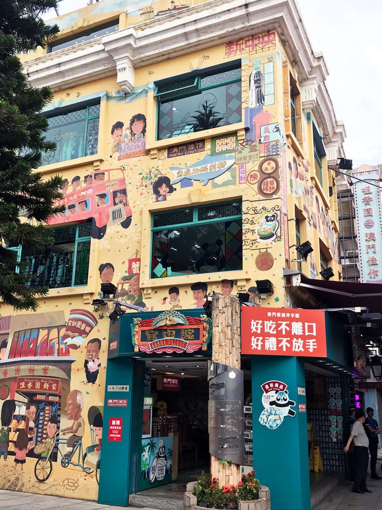 A colourful full-scale mural painted on the shop front of Cunha Bazaar