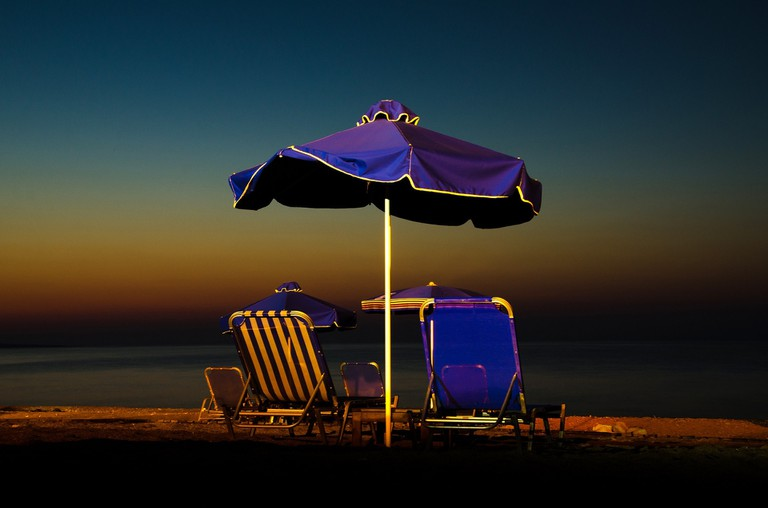 The camp's beach is set up with a few sun beds where you can relax in the day and stargaze at night