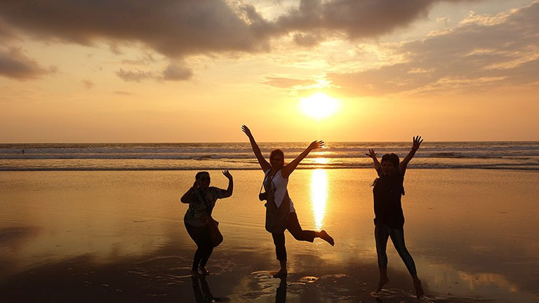 Sunset on the beach with friends in Bali