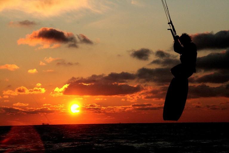 Kite surfing at sunset