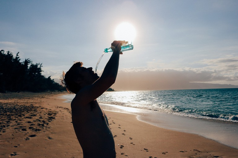 Drinking water while enjoying the beach is essential, as you're completely exposed to the sun
