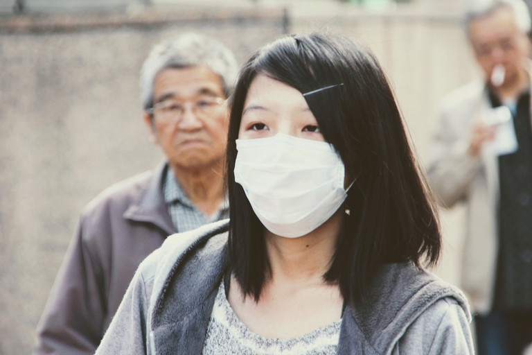 Even after face masks are proven ineffective, New Yorkers wear masks to mark themselves as uninfected.