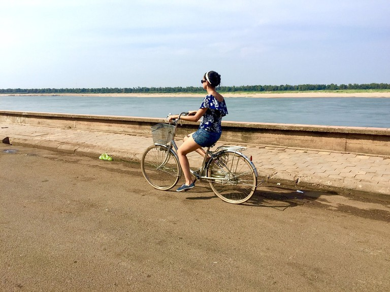 Cycling by the Mekong River