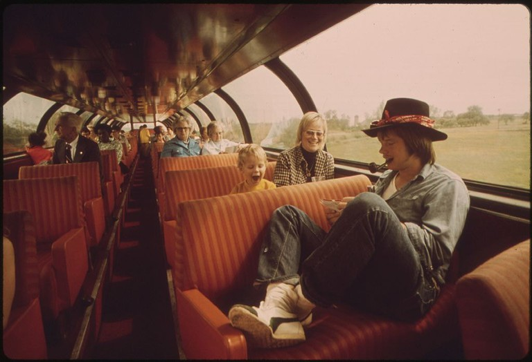 PASSENGERS_RELAX_AND_VIEW_THE_SCENERY_FROM_THE_LOUNGE_CAR_OF_THE_EMPIRE_BUILDER_ENROUTE_FROM_CHICAGO_TO_EAST_GLACIER..._-_NARA_-_556080