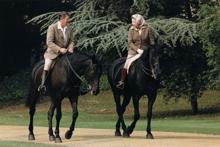 President Ronald Reagan and Queen Elizabeth II riding horses in 1982