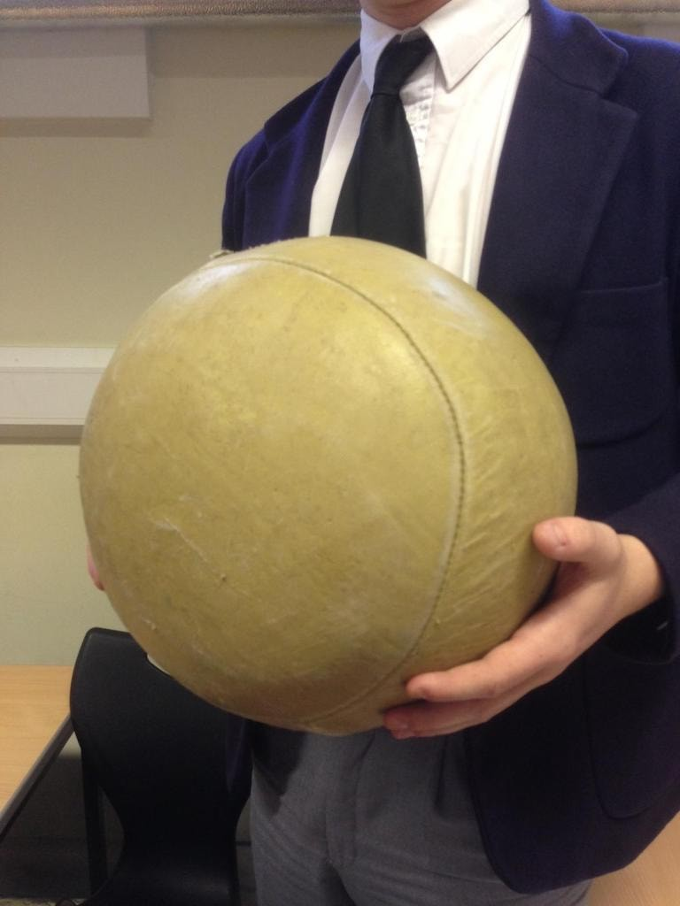 Pupil holding a Harrow football
