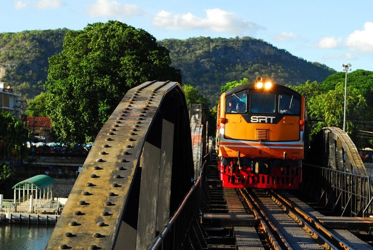 A local Thai train passes over the Bridge on the River Kwai