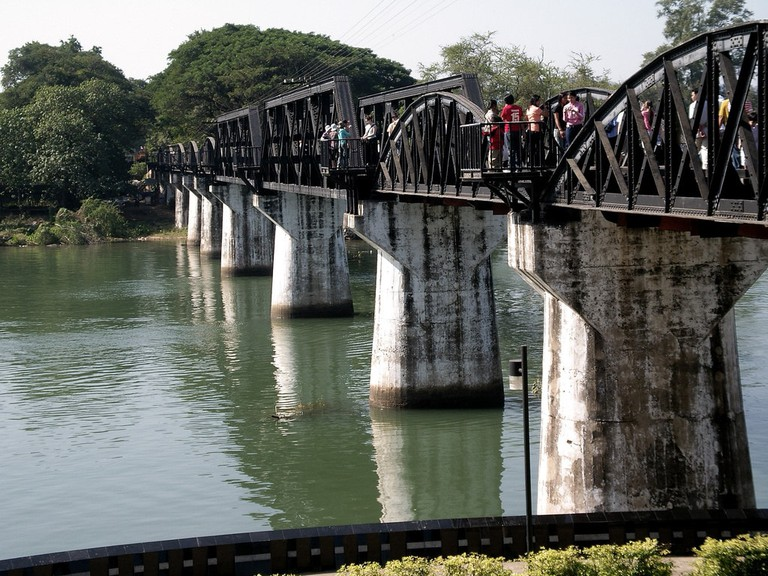 Tourists walking across the Bridge on the River Kwai