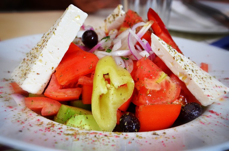 Dive into Greek salad with lots of feta cheese and olive oil