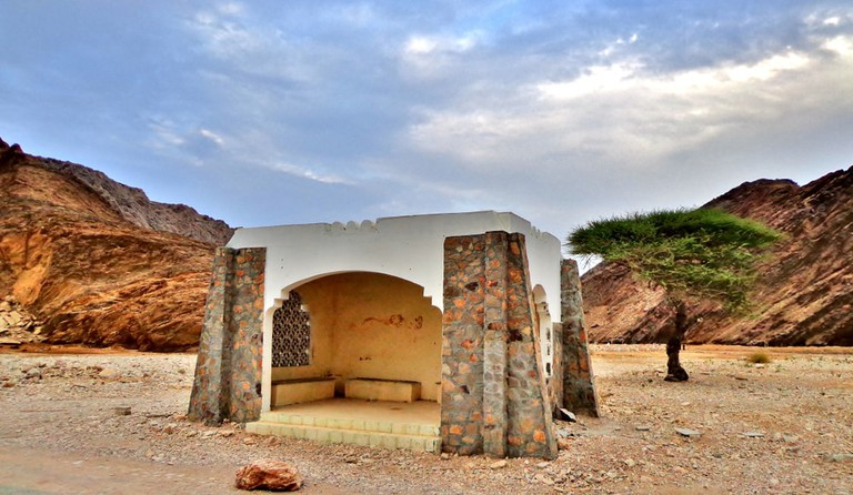 A traditional covered bus stop in Oman