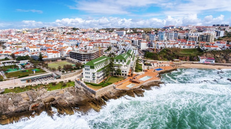 Aerial view of the town of Ericeira coasts and streets.