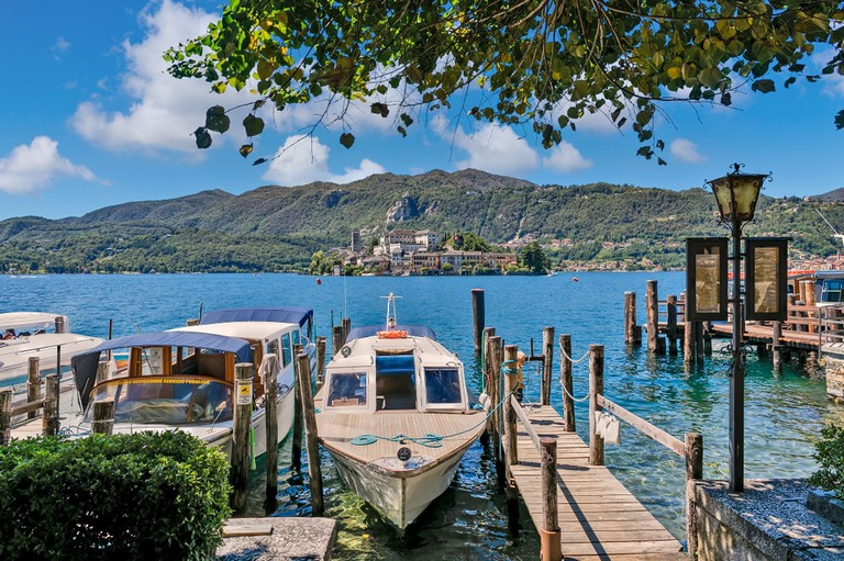 Lake Orta's island as seen from a pier in charming village of San Giulio, Piedmont, Northern Italy