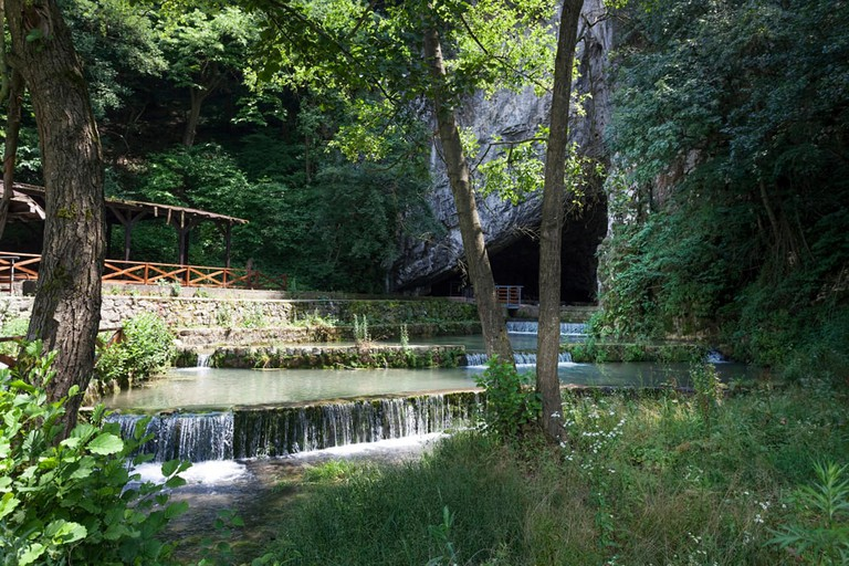 Petnica cave entrance and strong spring that flows out near Valjevo, Serbia