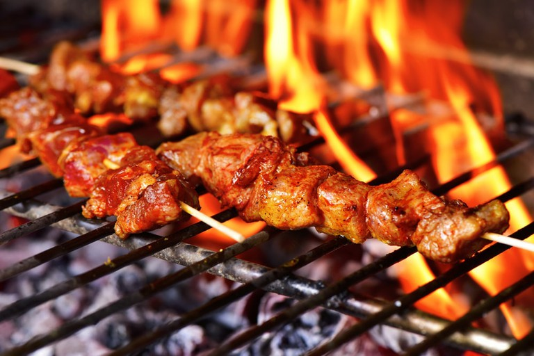 Meat skewers being grilled on a barbecue