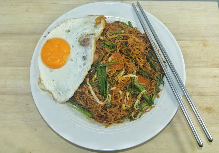 Fried rice vermicelli (mee hoon or bihun) served with fried egg