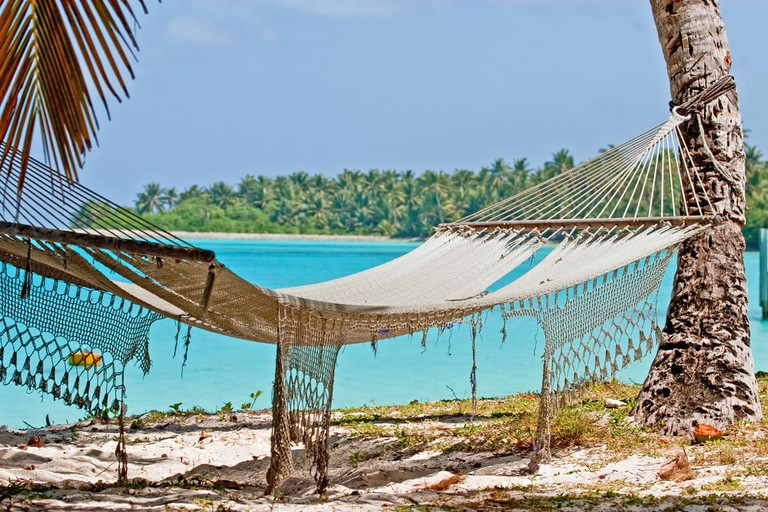 Hammock between palm trees on Direction Island in Cocos Keeling.