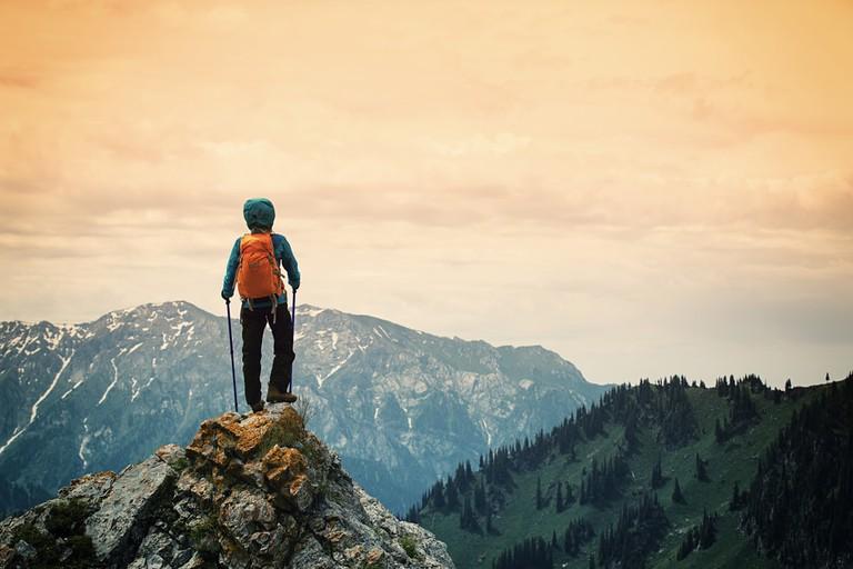 Backpacker on mountain peak