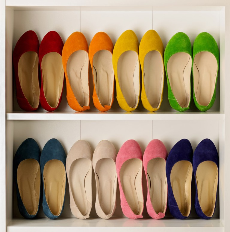 Rows of colourful women's ballet shoes
