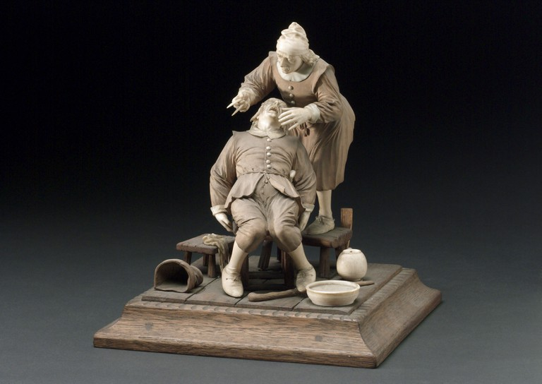 5. Wood and ivory figure group depicting a tooth extraction, 17th century, Science Museum Science & Society Picture Library